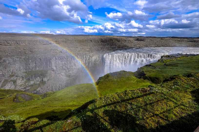 Image of rainbow over a waterfall.