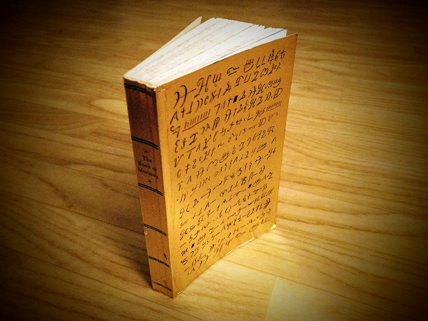 Image of a gold cover paperback edition of the Book of Mormon