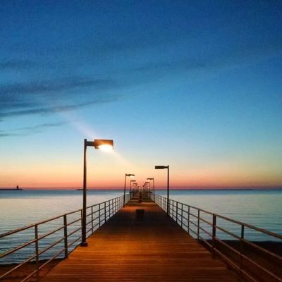 Image of Lake Huron viewed from a pier before sunrise