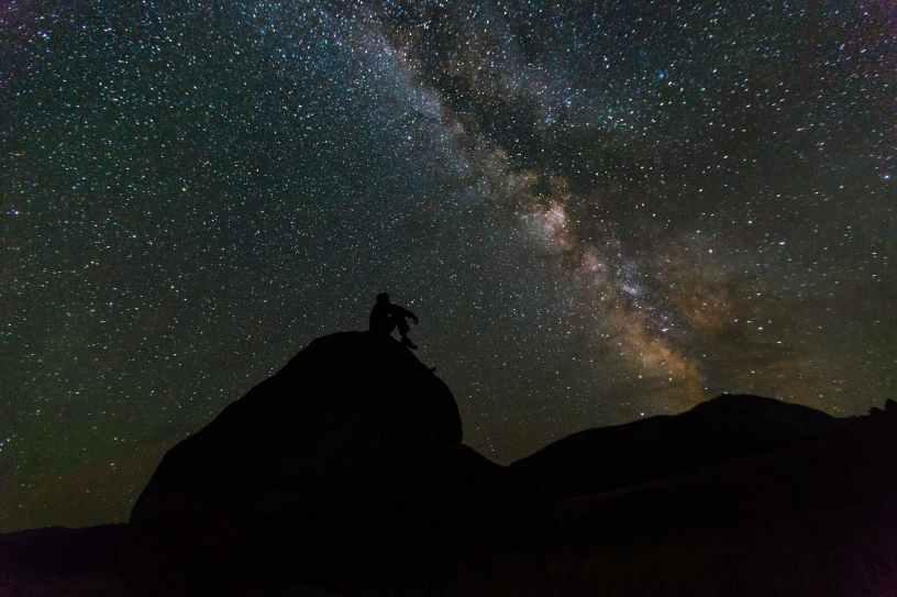 man looking at the Milky Way