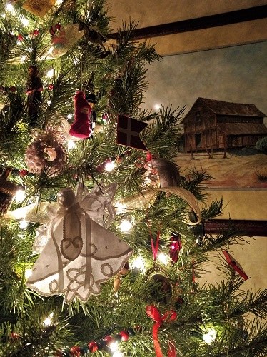 Christmas Tree decorated with painting of barn behind