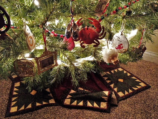 Christmas tree skirt and low-hanging ornaments
