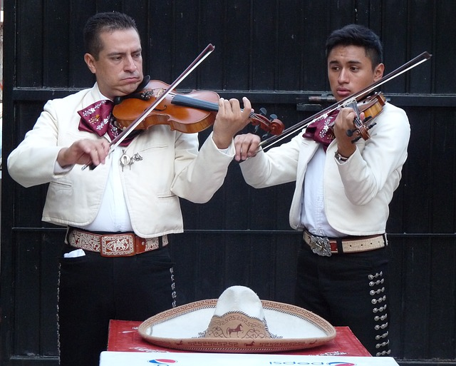 two mariachi musicians in traditional dress