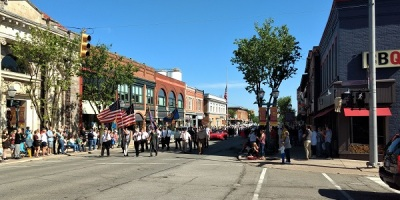 Memorial Day parade in Chelsea, led by a color guard bearing the American flag