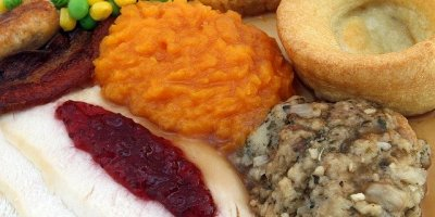 A full plate of Thanksgiving favorites, featuring a helping of cranberry sauce