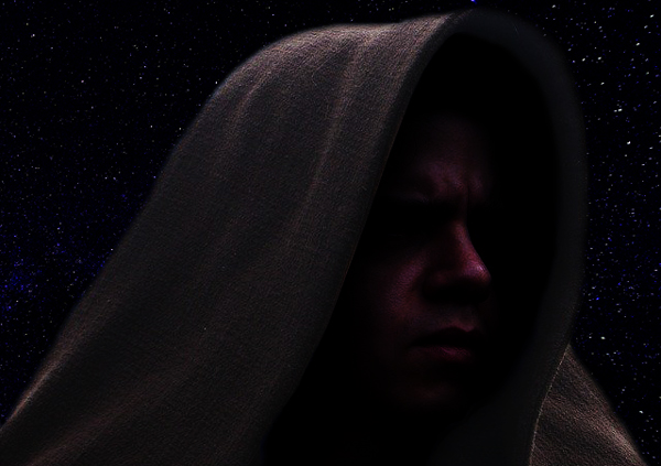 Cosplay image of a Star Wars Jedi set against a starry sky