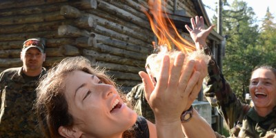 A NASA astronaut candidate successfully starts a fire during her survival training