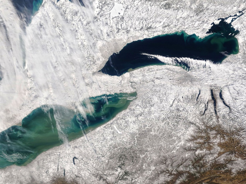 Lakes Erie and Ontario and the land around them covered in lake effect snow, as seen from space