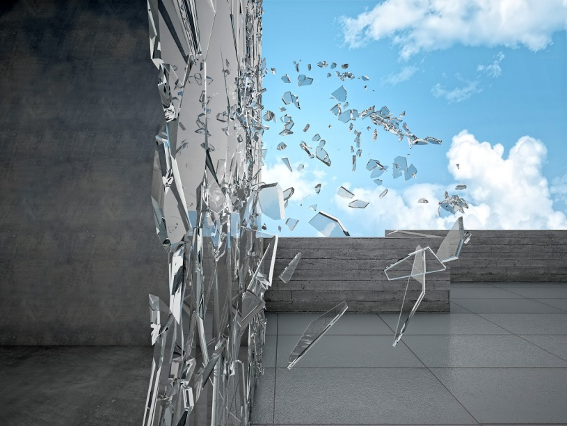 shattering glass exterior of a building