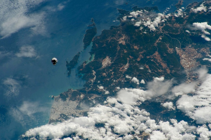SpaceX Dragon capsule Endeavor flying over Earth